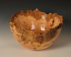 An exquisitely turned, 13-inch diameter natural edge bowl.