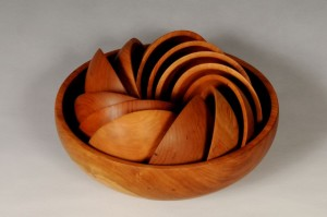 A large salad bowl and 12 individual size bowls turned by Richard Cruise.