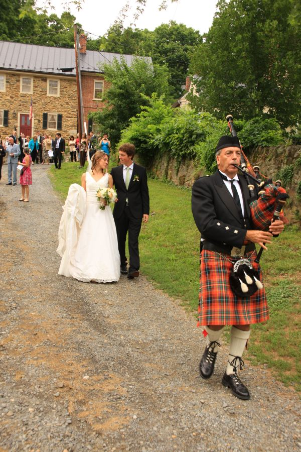 Walking down Liggett Street with a bag piper after a JWC wedding