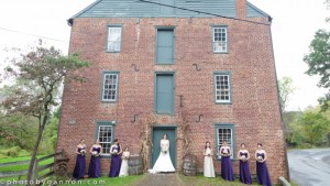 Wedding at the Mill with bridesmaids and bride by the front